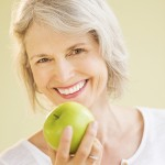 Happy Woman Holding Granny Smith Apple